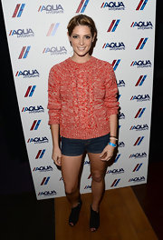 Ashley paired her uber preppy look with a pair of dark-wash denim shorts.