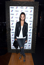 Cara Santana was rocker-chic in ripped jeans and a leather jacket at the AQUAhydrate private event.