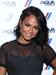 Christina Milian wore her hair in high-volume waves with one side pinned back during the AQUAhydrate private event.