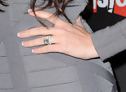Khloe showed off her massive wedding ring while hitting the 'One Night Only' party.