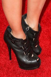 Adrienne Bailon looked trendy, and a little bit touch, in these black leather buckled booties.