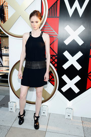 Coco Rocha completed her outfit with chunky black cutout boots.