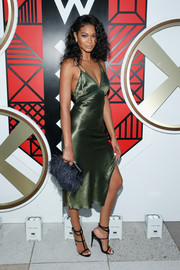 Chanel Iman added extra allure with a pair of black gladiator heels.