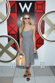 Harley Viera-Newton went for a classic summer look in a spaghetti-strap gingham-print dress during the W Amsterdam event.