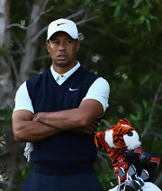 Tiger paired this navy v-neck sweater vest over a teal polo for a sleek look while on the course.