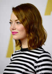 Emma Stone wore her bobbed hair in very loose waves at the Academy Awards Nominee Luncheon.