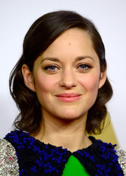 Marion Cotillard wore her hair loosely curled and pinned back for the Academy Awards Nominee Luncheon.