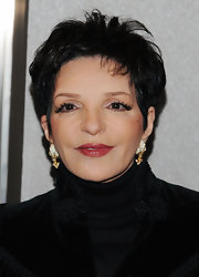 Liza Minnelli always manages to look simple yet expensive as she wore a par of diamond-studded fan earrings at a ribbon cutting ceremony.