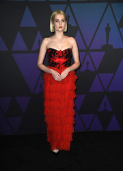 Lucy Boynton brought a Valentine vibe to the 2018 Governors Awards with this strapless red gown by Rodarte.