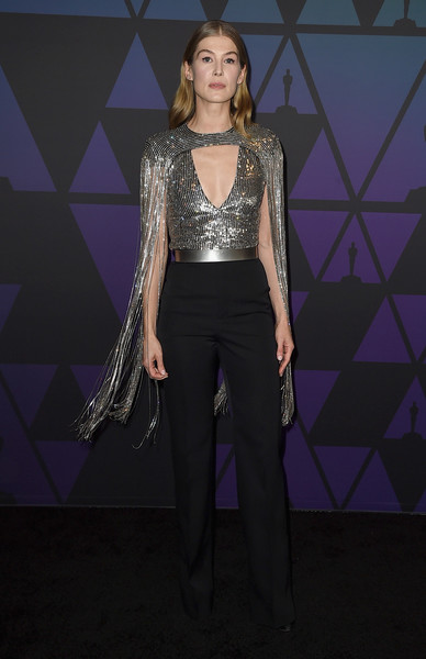 Rosamund Pike looked disco-ready in a Givenchy jumpsuit with a sequined bodice and a fringed capelet at the 2018 Governors Awards.