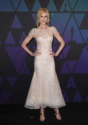 Nicole Kidman paired her lovely dress with nude satin sandals by Sophia Webster.