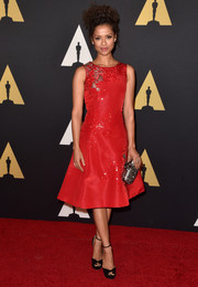 Gugu Mbatha-Raw polished off her look with a beaded silver clutch by Oscar de la Renta.