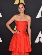 Marion Cotillard added a hint of edge via black nail polish.