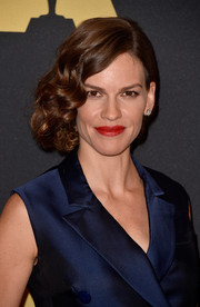 Hilary Swank styled her locks into a curly faux bob coquettishly swept to one side for the Governors Awards.