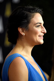 Jenny Slate opted for simple diamond studs when she attended the 2014 Governors Awards.