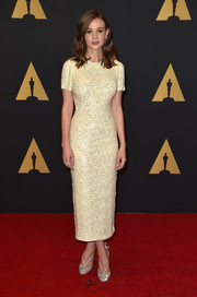 Carey Mulligan went for simple sophistication in a shimmery pale-yellow midi dress by Jonathan Saunders during the Governors Awards.
