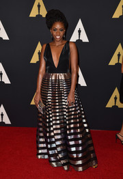 Teyonah Parris made a head-turning entrance in a Pedram Couture gown with a down-to-there neckline during the Governors Awards.