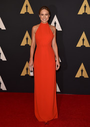 Brie Larson cut a sleek, elegant figure at the Governors Awards in a red halter gown by Calvin Klein.