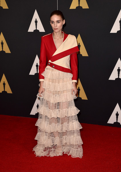 For her Governors Awards look, Rooney Mara played with contrasts, teaming a masculine-chic jacket with a sheer ruffle gown, both by Alexander McQueen.