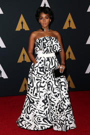 Janelle Monae finished off her look with a simple black box clutch.