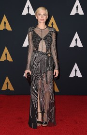 Michelle Williams went for edgy glamour at the Governors Awards in a partially sheer, swirl-beaded gown by Louis Vuitton.