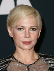 Michelle Williams attended the Governors Awards wearing her signature short blonde cut.