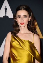 Lily Collins looked divine wearing this half-up wavy hairstyle at the Governors Awards.