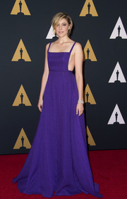Greta Gerwig flashed some side cleavage in this purple Emilia Wickstead gown at the Governors Awards.