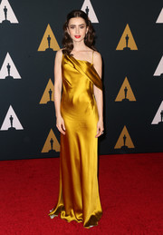Lily Collins exuded Old Hollywood glamour in this asymmetrical marigold satin gown by Amanda Wakeley at the Governors Awards.