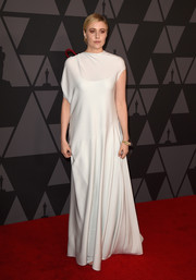 Greta Gerwig looked simply divine in an asymmetrical ivory gown by The Row at the Governors Awards.