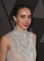 Zoe Kazan attended the Governors Awards wearing her hair in double French braids.