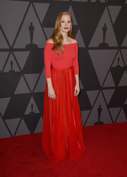 Jessica Chastain was a vision in a red off-the-shoulder gown by Alexander McQueen at the Governors Awards.