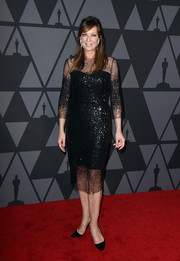 Allison Janney made an ultra-elegant choice with this black sheer-panel sequin dress by Monique Lhuillier for her Governors Awards look.