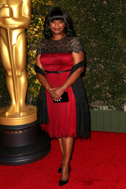 Octavia Spencer looked very ladylike in a red and black lace-panel cocktail dress by Tadashi Shoji during the Governors Awards.