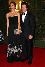 Rhea Durham chose a lovely black strapless gown with floral accents on the skirt for her Governors Awards look.