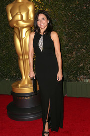 Julia Louis-Dreyfus stepped out on the Governors Awards red carpet wearing a black David Meister evening dress featuring embellished keyhole detailing.
