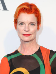 Sandy Powell turned heads with her orange-dyed boy cut at the Hollywood Costume opening party.