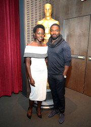 Lupita Nyong'o was all about simple elegance in a white off-the-shoulder dress with black stripe accents at the official Academy screening of 'Queen of Katwe.'