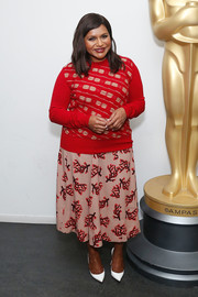 Mindy Kaling went mismatched-chic in this pink branch-print skirt and patterned red sweater by Marni.