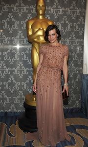 Milla Jovovich looked divine in this beige beaded gown at the Academy Technical Awards.