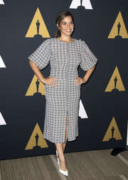 America Ferrera completed her outfit with simple white pumps.