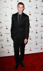 Cameron Monaghan made a grand entrance at the Academy of Television Arts & Sciences' 63rd Primetime Emmy Awards performers nominee reception in a stylish black suit.