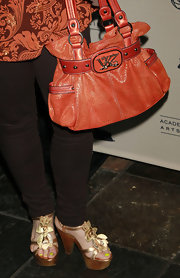 Charlene Tilton stepped out at the Academy of Television Arts & Sciences' Performers Peer Group event wearing a pair of floral strapped clogs.