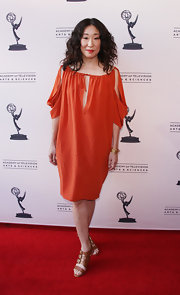 Sandra Oh wore this billowing orange cutout dress to the Evening With Shonda Rhimes & Friends.