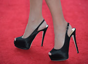 Kristin added some major height to her petite frame with these black satin, peep toe, sling back sandals.