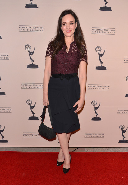 Madeleine Stowe's red carpet look was both mature and classic with a ruffled pencil skirt and bow belt.