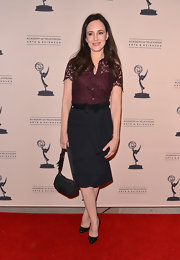 A feminine lace blouse took Madeleine Stowe's red carpet look from classy to glamorous.