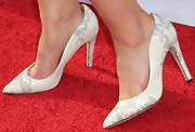 Katie Lowes chose a pair of white and gray snakeskin pumps to top off her look.