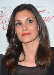 Daniela Ruah added some color to her monochromatic wardrobe with bright red lips.