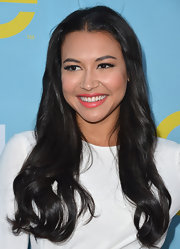 Naya Rivera wore her silky hair flowing over her shoulders at a screening of 'Glee.'